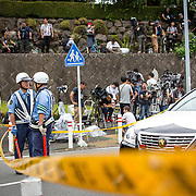 SAGAMIHARA, JAPAN - JULY 26 :  Police officers guard the front of gate as they continue to investigate on knife attack in a handicap center in Tsukui Yamayuri-en building at Sagamihara on Wednesday, July 26, 2016 in Kanagawa prefecture, Japan. Police arrested 26 year old Satoshi Uematsu after breaking inside the building facility for handicapped and killing 19 people and injuring 20 in the city of Sagamihara, west of Tokyo. (Photo: Richard Atrero de Guzman/NURPhoto)