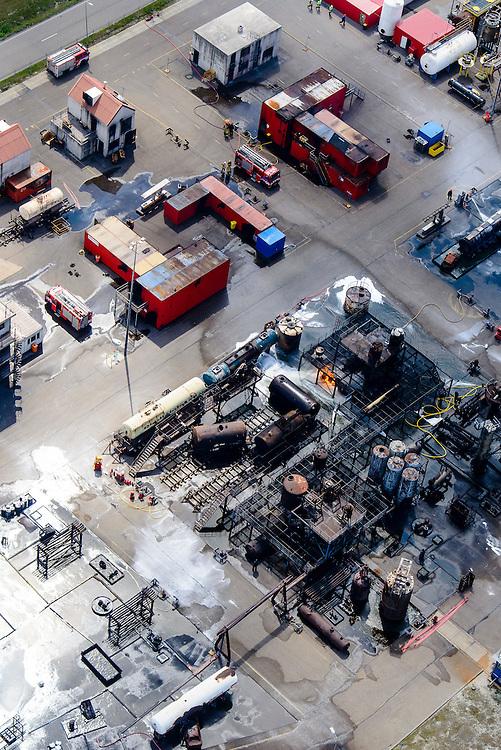 Nederland, Zuid-Holland, Rotterdam, 06-10-2015. 'brandweer dorp', opleidingscentrum en oefencentrum van Falck Risc (Falck Fire Academy) voor het trainen en oefenen van bedrijfsbrandweer en brandweercorpsen.<br /> 'Firefighter village ' training center of Risc Falck (Falck Fire Academy) for the training and practice of (industrial) fire-fighters and fire departments.<br /> <br /> luchtfoto (toeslag op standard tarieven);<br /> aerial photo (additional fee required);<br /> copyright foto/photo Siebe Swart