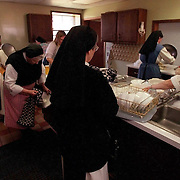 Nuns at Our Lady of the Mississippi Abbey, clean up in the kitchen of their monastery near Dubuque, Iowa.    The community of 22 Roman Catholic women follow Jesus Christ through a life of prayer, silence, simplicity and ordinary work.  Their home is a beautiful monastery which sits high on a bluff, overlooking the Mississippi River.