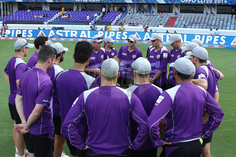 Hobart team huddle during the first semi final match of the Oppo Champions League Twenty20 between the Kolkata Knight Riders and the Hobart Hurricanes held at the Rajiv Gandhi Cricket Stadium, Hyderabad, India on the 2nd October 2014<br /> <br /> Photo by:  Ron Gaunt / Sportzpics/ CLT20<br /> <br /> <br /> Image use is subject to the terms and conditions as laid out by the BCCI/ CLT20.  The terms and conditions can be downloaded here:<br /> <br /> http://sportzpics.photoshelter.com/gallery/CLT20-Image-Terms-and-Conditions-2014/G0000IfNJn535VPU/C0000QhhKadWcjYs