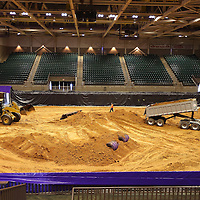 Adam Robison | BUY AT PHOTOS.DJOURNAL.COM<br /> Feld Motorsports, the dirt crew responsible for setting up the dirt race course for Monster Jam, moves the dirt into the BancorpSouth Arena Thursday morning in Tupelo. This is the first year dirt will be used for Monster Jam at the Arena.