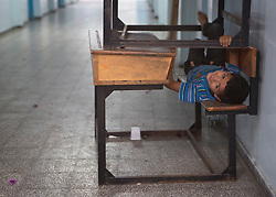 """© Licensed to Alison Baskerville. 14/07/2014. Gaza.   Following a warning from the Israeli Defence Forces (IDF) over 600 people have evacuated their homes from the north of Gaza and taken refuge in a UN School.  Many left with limited supplies.  With no sign of the crisis ending the school is now concerned that they will run out of water and supplies.  """"I don't know how much longer we will be able to go on in this situation.""""  Commented Abdil Sawan, the UN representative within the school. Photo credit : Alison Baskerville/LNP"""