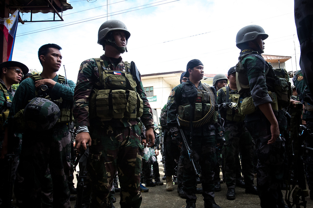 MARAWI, PHILIPPINES - JUNE 6: Striking force of the Philippine National Police or RPSB listens to instructions of the officer before search operation of firearms and explosives inside a restricted area of Marawi City in Southern Philippines, June 6, 2017. (Photo: Richard Atrero de Guzman/NUR Photo)