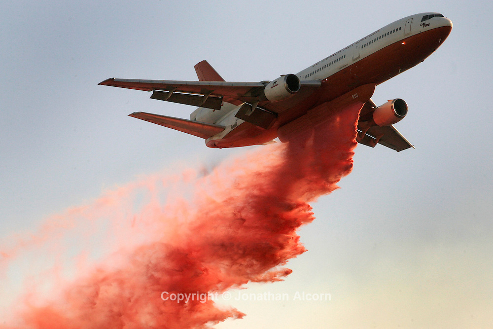 Nov 16, 2008 - Diamond Bar, California, USA - CalFire's specially modified for firefighting DC-10 aircraft drops phos-chek on the Triangle Complex fire in Diamond Bar on Sunday, November 16 , 2008.