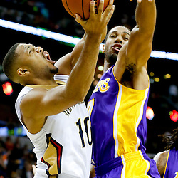 Nov 8, 2013; New Orleans, LA, USA;  New Orleans Pelicans shooting guard Eric Gordon (10) shoots over Los Angeles Lakers small forward Xavier Henry (7) during the second quarter of a game at New Orleans Arena. Mandatory Credit: Derick E. Hingle-USA TODAY Sports