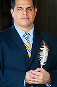 Native American executive Anthony Patricio with the eagle feather given him by his grandmother.