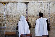 Israel, Jerusalem, Old City, Two Jewish men pray at the Wailing Wall