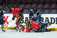 PENTICTON, CANADA - SEPTEMBER 11: Glenn Gawdin #80 and Juuso Valimaki, #42 of Calgary Flames get tangled up with Kristian Reichel #90 and Tyler Boland #89 of Winnipeg Jets on September 11, 2017 at the South Okanagan Event Centre in Penticton, British Columbia, Canada.  (Photo by Marissa Baecker/Shoot the Breeze)  *** Local Caption ***