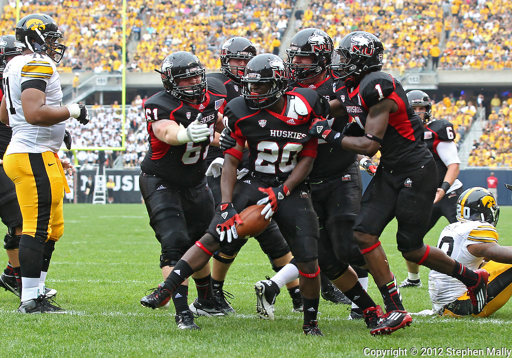 September 01 2012: Northern Illinois Huskies running back Keith Harris Jr. (20) celebrates his touchdown run during the first half of the NCAA football game between the Iowa Hawkeyes and the Northern Illinois Huskies at Soldiers Field in Chicago, Illinois on Saturday September 1, 2012. Iowa defeated Northern Illinois 18-17.