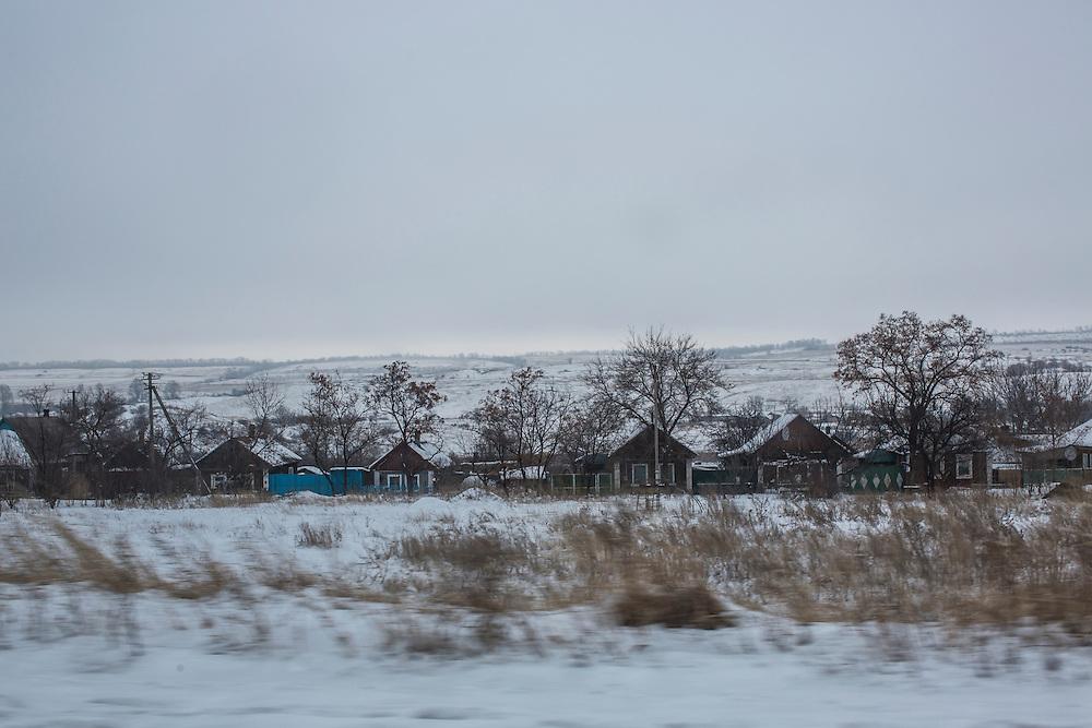 YURIVKA, UKRAINE - DECEMBER 8, 2014: Houses along the road near Yurivka, Ukraine. CREDIT: Brendan Hoffman for The New York Times