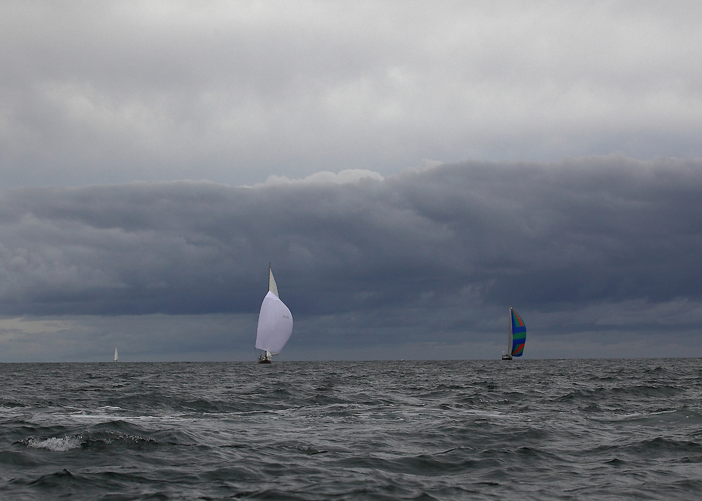 Spinnakers and an ominous cloud at the 2010 Newport Bucket. Super yachts racing in the 2010 Newport Bucket.