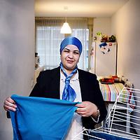 Nederland, Amsterdam , 3 december 2013.<br /> Armoederapport: er zijn veel meer arme werkenden dan arme uitkeringgerechtigden. Met portret van arme werkenden. <br /> <br /> Portret van schoonmaakster Khadija Tahiri (44) die werkt maar niet kan rondkomen met haar hele gezin. Werkt in Amsterdam bij het Hago in het Boven IJ ziekenhuis.<br /> Despite her work as a cleaner, Khadija Tahiri does not earn enough to pay all the bills.