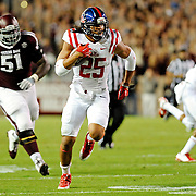 Mississippi defensive back Cody Prewitt (25) returns an interception for a touchdown during the first half of an NCAA college football game against Texas A&M in College Station, Texas, Saturday, Oct. 11, 2014. (Photo/Thomas Graning)