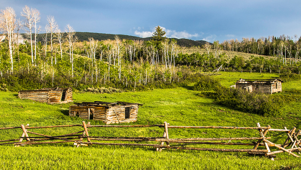 Rays at sunset illuminate an old and now abundoned ranch. This was once a scene site in a famous western movie. Teton valley, Wyoming.