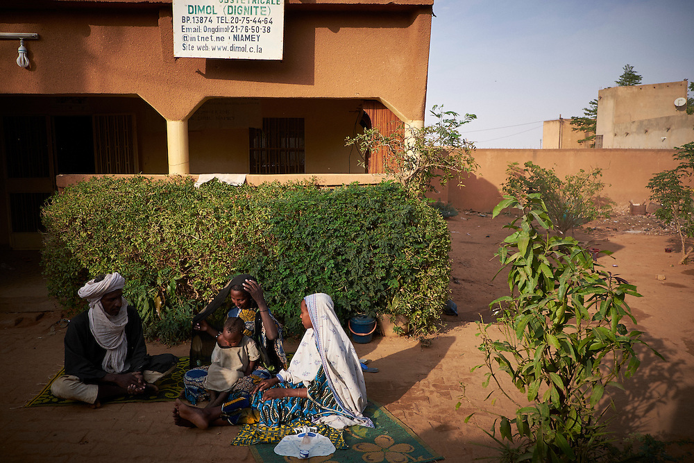 Aichatou Moussa, 16 years old with her father Moussa Ibadan, his wife Hawa Boubacar and her brother Rakia Moussa, 3 years old at the Centre of Female Victims of Fistula.Aichatou has been treated and accommodated at the centre for two weeks and may wait up to three months before her surgery. They come from Sabangori Aballak about 300km from Niamey. <br /> <br /> Aichatou - 'After I gave birth it began to hurt a lot and and I believed I was going to die and was so ashamed to not be able to control it (the urinating). After the operation it still hurts but not like before. I hope I will recover, I heard of stories with other women who came with more complicated cases than mine and they recovered. I am scared now of having the next baby though. For my children I want them to go to school because  I never did. &lsquo;<br /> <br /> Aichatou&rsquo;s father - 'Aichatou never went to school, there is not even a school in the village. She had the fistula after giving birth less than two months before to a stillborn baby. We returned to the village and one week later when we saw that the urine was not stopping we were referred to Niamey's main hospital. We were then referred to the NGO who the hospital has a partnership with in treating women with fistula.'