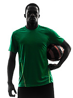 one african man soccer player green jersey holding football in silhouette on white background