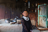 A young girl pauses for a photograph in her family tea stall in rural Nepal.
