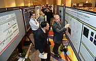 Washington, DC - The AACR Annual Meeting 2013: J. Jack Lee, left, from MD Anderson Cancer Center, listens closely as Christopher Hamilton presents his poster during the Eighth Annual Undergraduate Student Caucus and Poster Competition  at the the American Association for Cancer Research Annual Meeting here today, Saturday, April 6, 2013. More than 18,000 physicians, researchers, health care professionals, cancer survivors and patient advocates are expected to attend the meeting at the Walter Washington Convention Center. The Annual Meeting highlights the latest findings in all major areas of cancer research from basic through clinical and epidemiological studies. Date: Sunday, April 7, 2013 Photo by © AACR/Alan Lessig 2013 Technical Questions: todd@medmeetingimages.com; Phone: 612-226-5154.