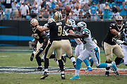 Thomas Davis(58) pressures Drew Bree's(9) in the New Orleans Saints 34 to 13 victory over the Carolina Panthers.