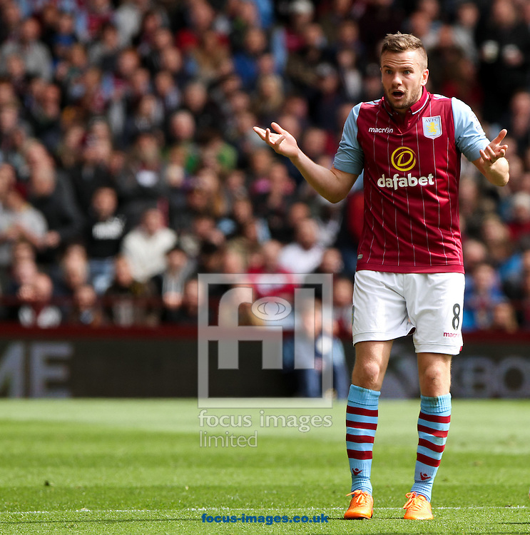 Tom Cleverley of Aston Villa argues with the linesmen during the Barclays Premier League match at Villa Park, Birmingham<br /> Picture by Tom Smith/Focus Images Ltd 07545141164<br /> 09/05/2015