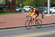 Kayla Richards bikes during the O'Bleness Race for a Reason Triathlon Saturday, April 27, 2013. The triathlon included a 500mm Serpentine Swim at the Ohio University Aquatic Center, a 15 mile bike ride to the Plains and back and then a 5k run that finished at Tailgreat Park across from Peden Stadium. . Race for a Reason, Race 4 A Reason, Annual Events, Events, Students, Faculty & Staff