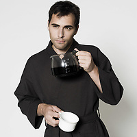 portrait of man in bathrobe drinking his coffee jar