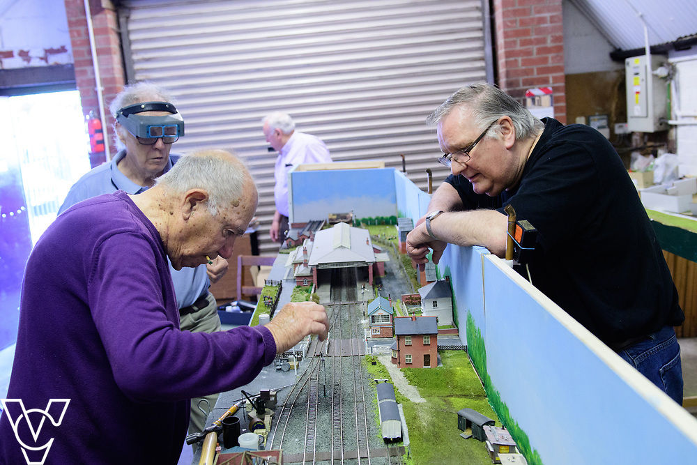 INSIGHT MAGAZINE: Bridlington Model Railway Society are based in Station Road, Bridlington, in a railway arch unit owned by Network Rail.  Pictured is, from left, Neil Porter, Trevor Pritchard (front left), Harold Bellhouse (back) and Graham Wilson working on the model of Filey station.<br /> <br /> Picture: Chris Vaughan Photography<br /> Date: May 31, 2017