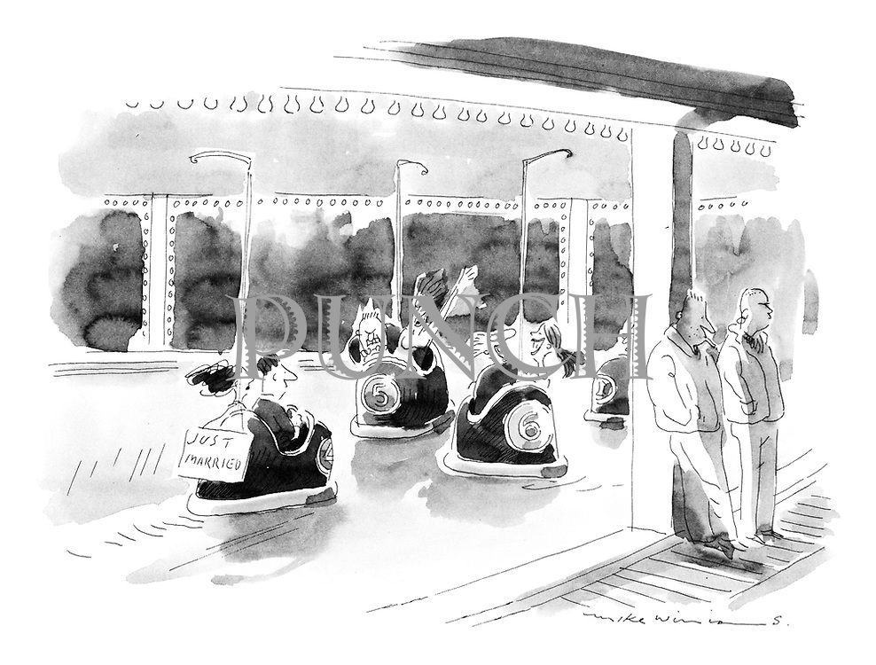 (Just married couple riding dodgems in fairground)