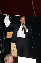 LORD DALMENY auctioning a sign pair of knickers from the film Bridget Jones  at the party Belle Epoque hosted by The Royal Parks Foundation and Champagne Perrier Jouet held at the Lido Lawns of the Serpentine, Hyde Park, London on 14th September 2006.<br />