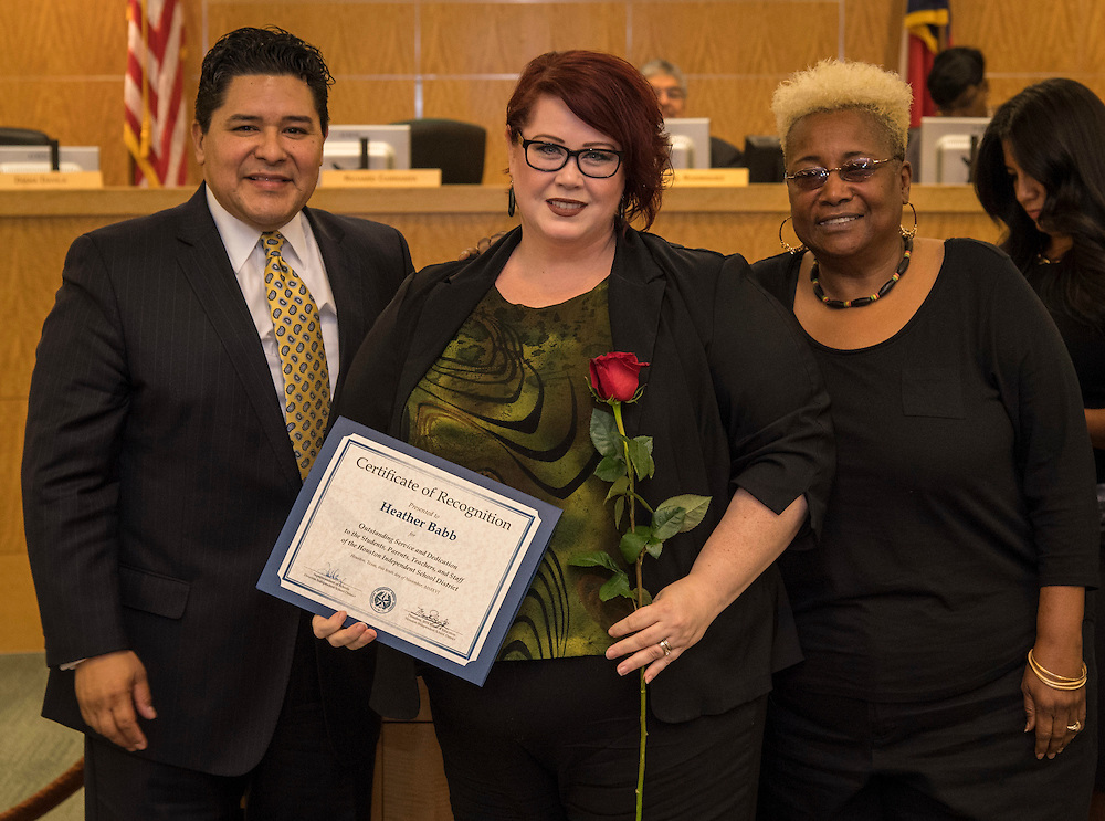 Superintendent Richard Carranza, left, and Wretha Thomas, right, recognize Heather Babb, center, during the Houston ISD Board of Trustee meeting, November 10, 2016.