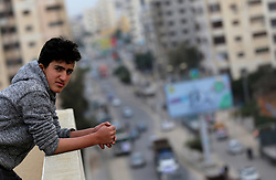 February 6, 2018 - Gaza City, Gaza Strip, Palestinian Territory - A Palestinian boy looks as truck drivers take part in a protest against the siege on the Gaza Strip, on February 6, 2018 in Gaza City. Israel has maintained a siege on Gaza for a decade which it says is necessary to limit Hamas, the Islamist movement that runs the strip and with which it has fought three wars since 2008. Egypt has also kept its border with Gaza largely closed in recent years, but has allowed some fuel to be imported  (Credit Image: © Yasser Qudih/APA Images via ZUMA Wire)