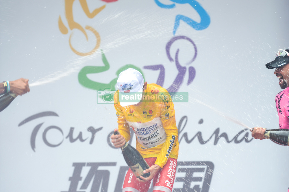September 24, 2017 - Zhuhai, Guangdong, China - The 2017 Tour of China 2 Winner, Kevin Rivera Serran (Androni Sidermec Bottecchia), celebrates his win with Mirko Trosino (Wilier Triestina - Selle Italia) and Mauricio Ortega Ramirez (RTS - Monton Racing Team) during the Awards Ceremony. .On Sunday, 24 September 2017, in Hengqin district, Zhuhai City, Guangdong Province, China. (Credit Image: © Artur Widak/NurPhoto via ZUMA Press)