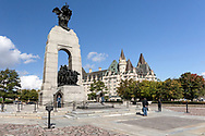 The National War Memorial and Fairmont Chateau Laurier in Ottawa Ontario, Canada. The 21.34 m (70 ft) granite memorial arch and bronze sculptures was built in 1939 to commemorate the soldiers dying in the First World War but now represents all Canadians killed in any conflicts in the past or future.