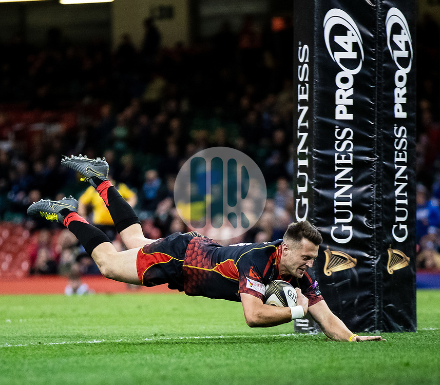 Josh Lewis of Dragons scores his sides third try<br /> <br /> Photographer Simon King/Replay Images<br /> <br /> Guinness PRO14 Round 21 - Dragons v Scarlets - Saturday 27th April 2019 - Principality Stadium - Cardiff<br /> <br /> World Copyright © Replay Images . All rights reserved. info@replayimages.co.uk - http://replayimages.co.uk
