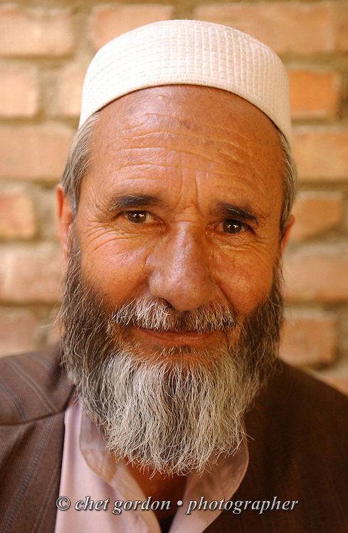 "An Afghan man pauses to have his portrait made in the courtyard of the Tahieya Maskan Orphanage for boys on Saturday, May 25, 2002. A humanitarian mission organized by The Geshundheit Instititute, founded by Dr. Hunter ""Patch"" Adams, Lufthansa Cargo, and DHL Worldwide Express collaborated to ship medicines, food and orthopedic supplies to the Indira Ghandi Children's Hospital, clinics and orphanages in Kabul. The German NGO (Non Governmental Organization) Hammer Forum supervised the distribution of the donated supplies from various non-profit organizations in the U.S. and The Netherlands."