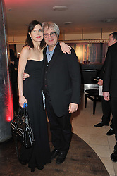 Actress ELIZABETH McGOVERN and her husband director SIMON CURTIS at the Costa Book Awards 2010 held at Quaglino's, 16 Bury Street, London on 25th January 2011.