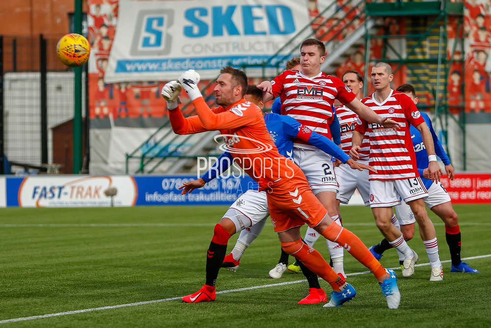 Rangers Keeper comes flying out and punches the ball away from danger during the Ladbrokes Scottish Premiership match between Hamilton Academical FC and Rangers at The Hope CBD Stadium, Hamilton, Scotland on 24 February 2019.