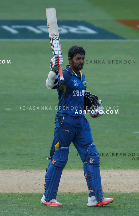 Lahiru Thirimanne raises his bat after reaching a milestone during the 2015 ICC Cricket World Cup Pool A group match between England Vs Sri Lanka at the Wellington Regional Stadium, Wellington, New Zealand.