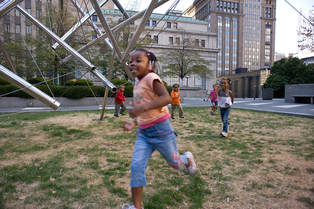 Chloe Wilson, age 4, runs through Mellon Square with other prescholers from Small World 2 Early Learning & Development Center in downtown Pittsburgh. The preschoolers take regular walks through downtown Pittsburgh.