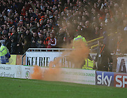 Smoke bomb thrown from United fans lands next to BT Sport cameraman - Dundee United v Dundee, SPFL Premiership at Tannadice<br /> <br />  - &copy; David Young - www.davidyoungphoto.co.uk - email: davidyoungphoto@gmail.com