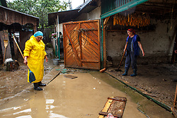 May 23, 2019 - Turia Poliana Village, Zakarpattia Region, Ukraine - Women clean a flooded yard in Turia Poliana village, Zakarpattia Region, western Ukraine, May 23, 2019. Due to bad weather that struck on the night of May 20 to 21, 146 cities and towns in five western Ukrainian regions were cut off power. As reported, emergency teams of local power companies are currently running repairs to resume electricity supply. Ukrinform. (Credit Image: © Serhii Hudak/Ukrinform via ZUMA Wire)