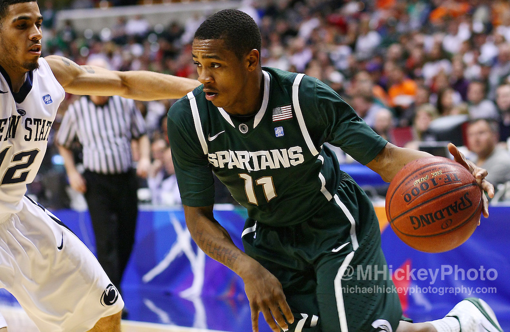 March 12, 2011; Indianapolis, IN, USA; Michigan State Spartans guard Keith Appling (11) dribbles along the baseline against Penn State Nittany Lions guard Talor Battle (12)  in the semi-final round of the 2011 Big Ten Tournament at Conseco Fieldhouse. Penn State defeated Michigan State 61-48. Mandatory credit: Michael Hickey-US PRESSWIRE