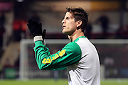 Norwich City defender Timm Klose (15) clapping his hands during the EFL Sky Bet Championship match between Brentford and Norwich City at Griffin Park, London, England on 31 December 2016. Photo by Matthew Redman.