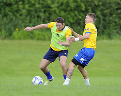 Bristol Rovers' Tom Parkes battles for the ball with Bristol Rovers' Eliot Richards - Photo mandatory by-line: Joe Meredith/JMP - Tel: Mobile: 07966 386802 24/06/2013 - SPORT - FOOTBALL - Bristol -  Bristol Rovers - Pre Season Training - Npower League Two