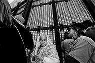 SAN YSIDRO, CA-APRIL 16:  Alejandra Valles, 94, with other worshipers during in a bi-national Easter mass along the U.S.-Mexico border fence at Friendship Park in San Ysidro, California on Sunday, April 16, 2017.