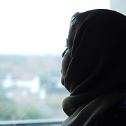 """""""My friend started to wear the hijab. One day she went to the post office. At the counter the clerk serving her began speaking to her loudly and very slowly.. continuously asking her if she was understanding. My friend said there is not need to speak to me in this way. My friend was born and has lived in the UK for 30 years and ever since she has began wearing the hijab people has been treating her as if she doesn't know anything, does not speak the language.  In terms of terrorism, I am more wary of certain areas I am going to. I wouldn't feel very safe in areas of predominantly white working class like the Docklands for instance or certain areas in Hounslow. I wouldn't feel comfortable if it is late at night or I am on my own because  maybe it is just in my head but I hear of what is happening to muslim women being stripped of their scarves  off on the street, being shouted at, called names I just wouldn't feel same.  It happens frequently, I heard one lady was beaten up in Fulham and that's very west London and she was walking and a guy was very aggressive to her. She was wearing jilbab, the full cover, and he started to pull off her clothes and being shouting to go back to her country, effing terrorist, it is more like people are encouraged to come out and feel hatred towards others."""" A., October 2016."""