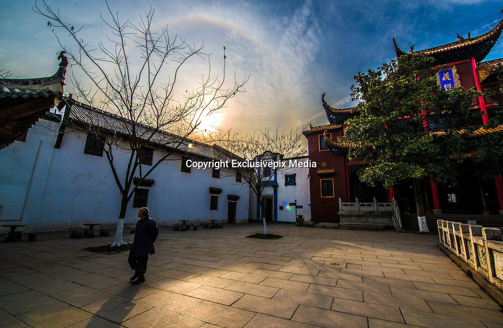 WUHAN, CHINA - JANUARY 26: (CHINA OUT) <br /> <br /> Solar Halo appears in sky above the Guiyuan Buddhist Temple on January 26, 2016 in Wuhan, Hubei Province of China. The solar halo attracted tourists and citizens. <br /> ©Exclusivepix Media