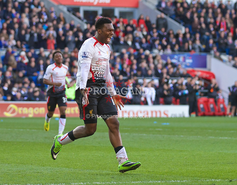 CARDIFF, WALES - Saturday, March 22, 2014: Liverpool's Daniel Sturridge celebrates scoring the fifth goal against Cardiff City during the Premiership match at the Cardiff City Stadium. (Pic by David Rawcliffe/Propaganda)