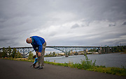 Photographs of lifestyle on the South Waterfront area of Portland, Oregon.  A senior man and his dachshund take a walk near the Willamette River.