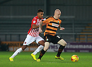 Barnet midfielder Nicky Bailey shields the ball from Exeter's Ollie Watkins during the Sky Bet League 2 match between Barnet and Exeter City at Underhill Stadium, London, England on 31 October 2015. Photo by Bennett Dean.